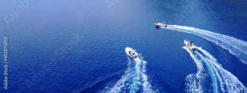 Obraz na plátně Aerial drone ultra wide top down photo of synchronised powerboats cruising in hi