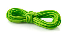 Green Nylon Cord Rolled Up Isolated On White. Still-life Picture Taken On Studio With White Background And Softbox.