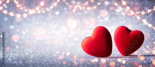 Obraz Two Hearts In Love On Silver Glitter With Abstract Defocused Background  - fototapety do salonu