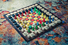 High Angle Shot Of Different Pieces Of Board Games On A Chessboard
