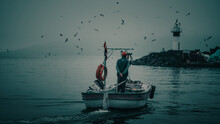 Majestic Back View Of A Fisherman In A Boat Sailing Having An Amazing Nature Scene In Front