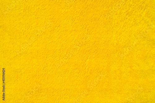 Photo Close-up light yellow suede fabric Velvet texture.