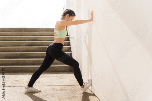 Fototapeta Beautiful asian woman outdoor exercise She is stretching obraz