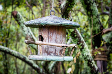 Weathered Wooden Birdhouse, Covered In Lichen.