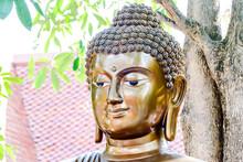 Closeup Shot Of A Golden Buddha Statue Head