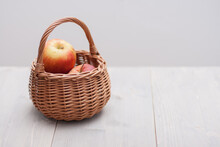 Apple In Basket On Table