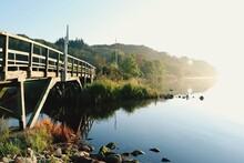 Footbridge Over River Against Clear Sky