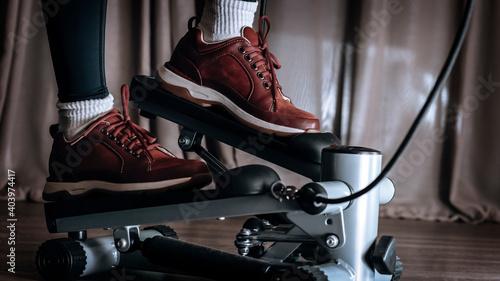 Fotografiet Mini Stepper Elliptical home gym equipment