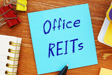 Business Concept Meaning Office REITs Real Estate Investment Trust With Sign On The Piece Of Paper.