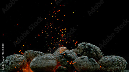 Canvas Print Charcoal briquettes ready for barbecue grill, close-up.