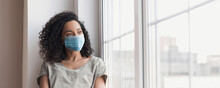 Sad Woman Alone During Coronavirus Pandemic Wearing Face Mask Indoors At Home For Social Distancing Panoramic Banner. Anxiety, Stress, Lockdown, Mental Health Crisis Concept.