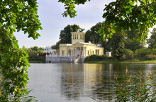 Kolonistsky Park In Peterhof. Tsaritsyn Pavilion In The Italian Style Of The XIX Century On The Bank Of Olga Pond Under The Branches Of Oaks