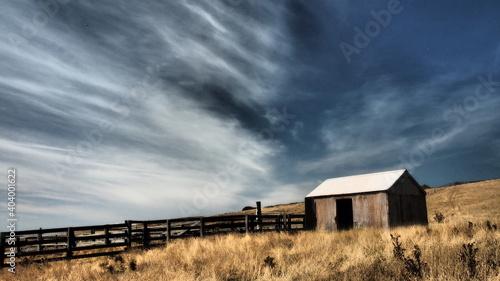 Fotografering Built Structure On Landscape Against Sky