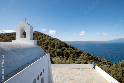 Fotografiet View of woman standing on the edge of the small chapel of Saint Alexander in Ski