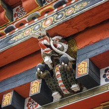 Colorful Traditional Painted Dragon Wood Sculpture Used As Corbel In Tashichho Dzong In Thimphu, Bhutan