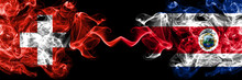 Switzerland, Swiss Vs Costa Rica, Coat Smoky Mystic Flags Placed Side By Side. Thick Colored Silky Abstract Smoke Flags.