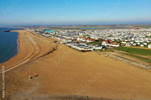 Aerial Photo of the large beach at Selsey in West Sussex with the large holiday caravan park at this destination Fotobehang