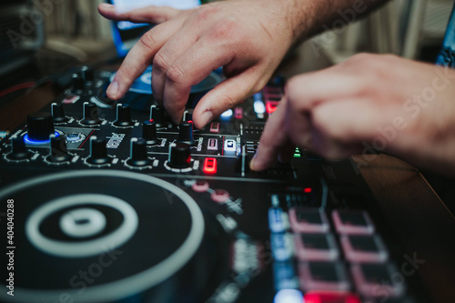 Obraz Closeup shot of a DJ's controller and his hands - fototapety do salonu