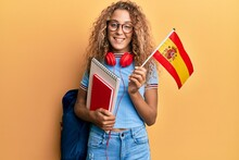 Beautiful Caucasian Teenager Girl Exchange Student Holding Spanish Flag Smiling With A Happy And Cool Smile On Face. Showing Teeth.