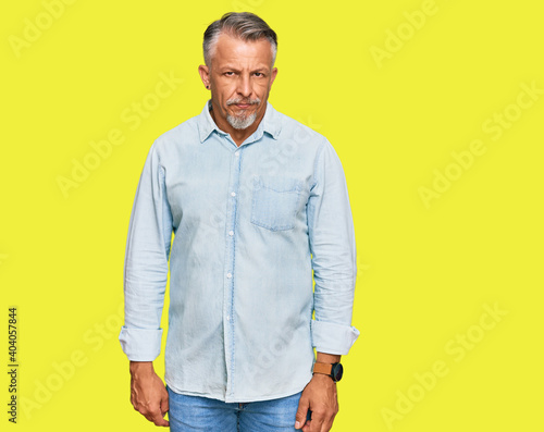 Fotografie, Obraz Middle age grey-haired man wearing casual clothes skeptic and nervous, frowning upset because of problem
