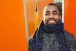 Leinwandbild Motiv Portrait Of Smiling Man Wearing Scarf