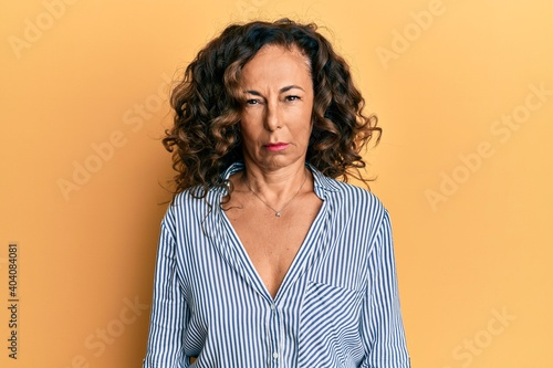 Obraz na plátně Middle age hispanic woman wearing casual clothes skeptic and nervous, frowning upset because of problem
