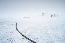 Aerial View Of A82 Road Through Rannoch Moor And Black Mount Covered In Snow During Winter
