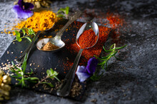 A Black Board With Colourful Spices Arranged For Cooking. Copy Space.