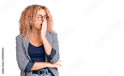 Canvas Young blonde woman with curly hair wearing business jacket and glasses bored yawning tired covering mouth with hand