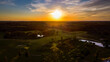 Aerial view of European centre golf club during sunset by drone
