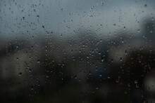 Rainy Drops On Window Glass With Blurry Building Background