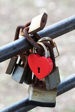 A Red Heart-shaped Lock As A Symbol Of Eternal Love Hangs On The Railing With Other Locks