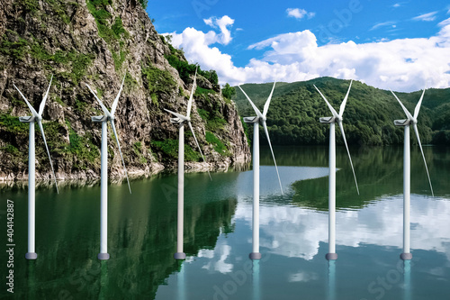 Fotografering Floating wind turbines installed in water near mountains