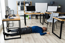 Office Slip And Fall Accident. Fainted Man