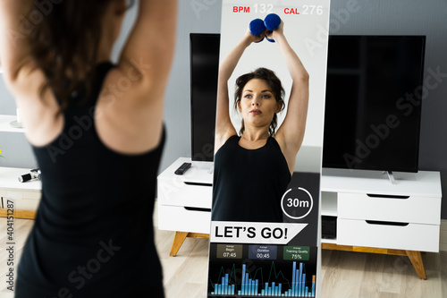 Fototapeta premium Fitness Exercise At Home Using Smart Mirror