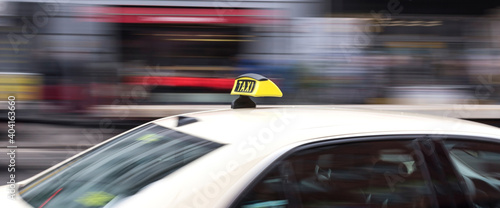 Fotografering Blurred Motion Of Taxi In City