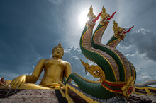 The Status Of King Of Nagas Stairway On The Front Of Big Golden Buddha In Wat Muang Temple, Landmark Of Angthong, Angthong Province, Thailand
