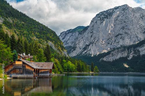 Waterfront wooden boathouse and lake Altaussee in Salzkammergut region, Austria Fotobehang