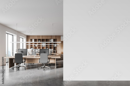 White and wooden open space office with mock up wall