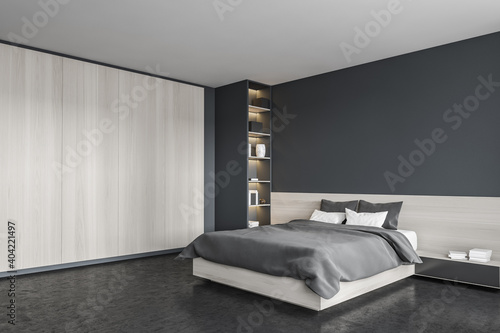 Black bedroom, bed with linens and wardrobe, bookshelf in the corner