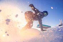 Snowboarder Woman On Snowboard Rides Through Snow Explosion. Freeride Snowboarding In Sheregesh Ski Resort