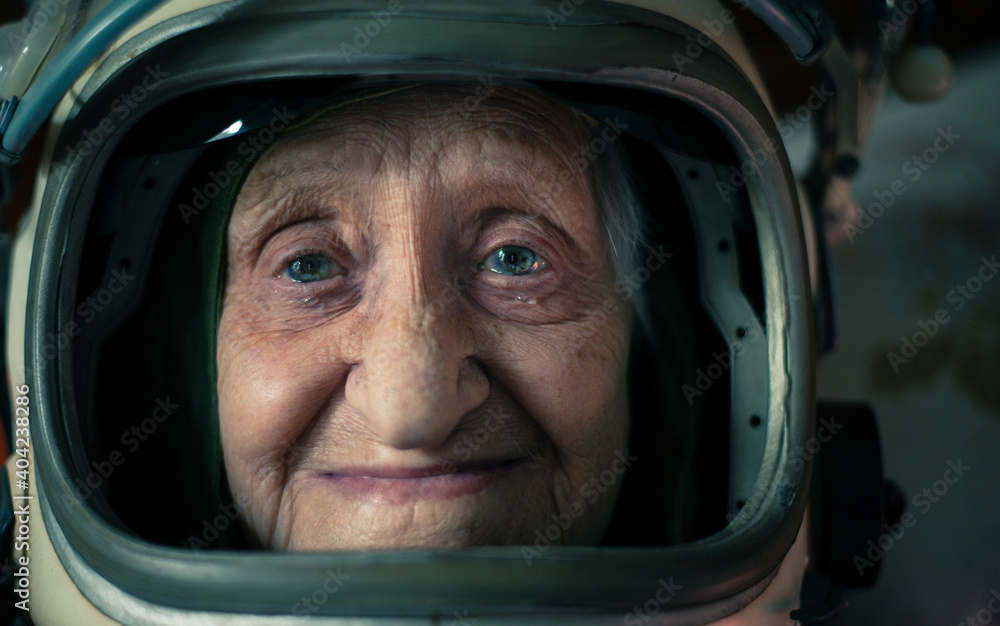 Fototapeta Cinematic portrait of an old astronaut coming back home