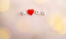The Word Love Consists Of Cubes With A Space For The Signature.