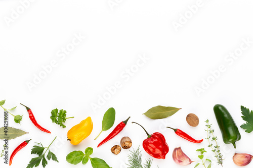 Fotografija Spice herbal leaves and chili pepper on white background