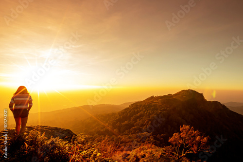 Fotografie, Obraz Beautiful sunset on the mountain in Ramkhamhaeng national park, Sukhothai province, Thailand