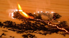 Lichtenberg Fractal Wood Burning. The Creation Of The Drawing In The Form Of Lightning On A Wooden Board. Short Circuit. Fire Spreads Across The Board. Close-up