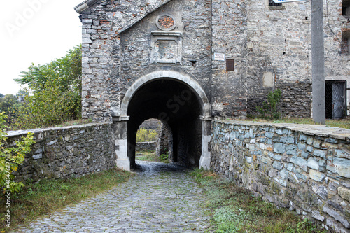 travel arch made of old cobblestone. Castle entrance Fototapeta