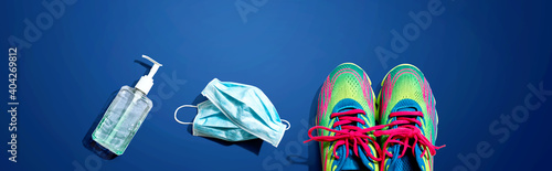 Fototapeta Fitness and coronavirus theme with running shoes - flat lay obraz