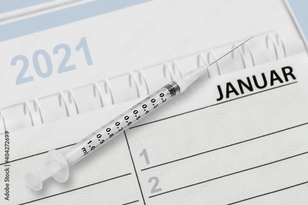 Fototapeta Kalender Januar 2021 und Spritze