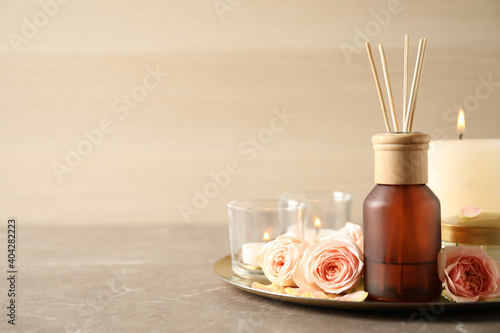 Obraz Spa composition with aroma oil and roses on grey table, space for text - fototapety do salonu